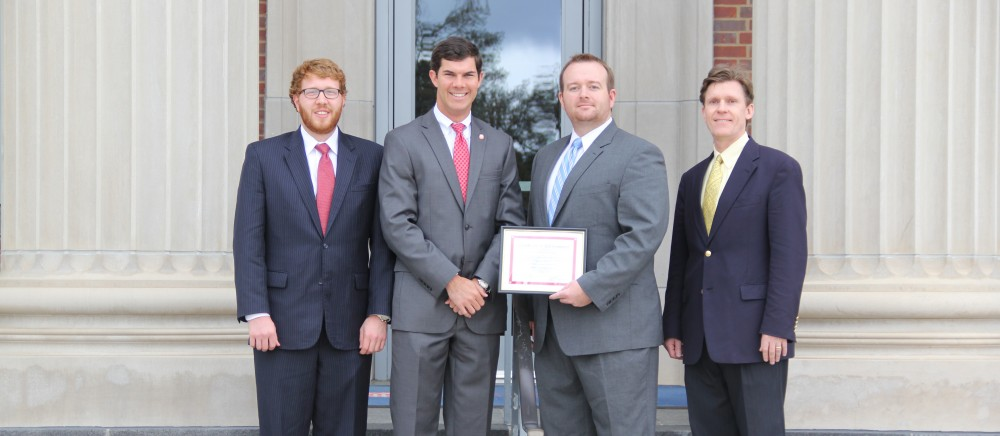 From left: Patrick Everman, chair of the Negotiation Board and student coach; Drew Taggart; Brad Cook; and Professor Mercer Bullard, faculty coach