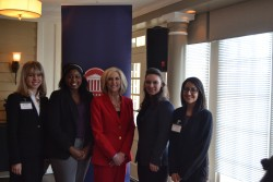 Student presenters Marie Wicks, Sampada Kapoor, Jessica Rice, and Izzy Robinson are pictured with State Treasurer Lynn Fitch.