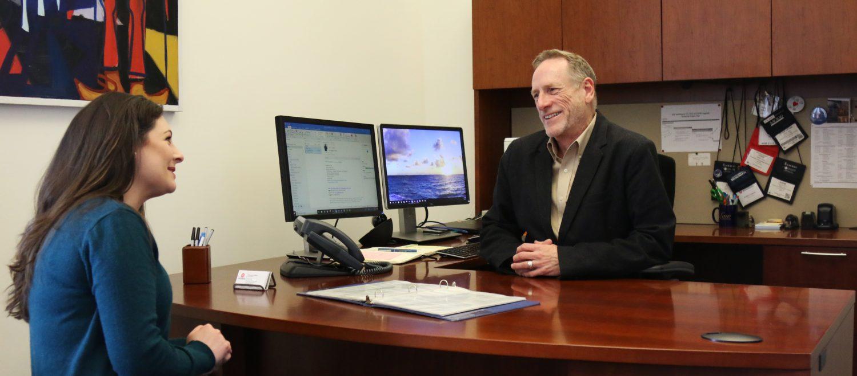 UM Law Registrar Eddie Upton speaks with third-year law student Brittney Eakins in his office.