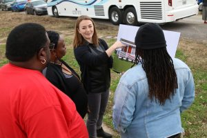 An architect shows residents of Eastmoor Circle renderings of their new homes.
